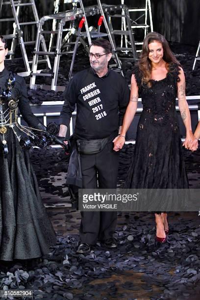 Fashion designer Franck Sorbier and the Godmother of the Collection daughter of Lio singer Nubia Esteban walk the runway during the Franck Sorbier...