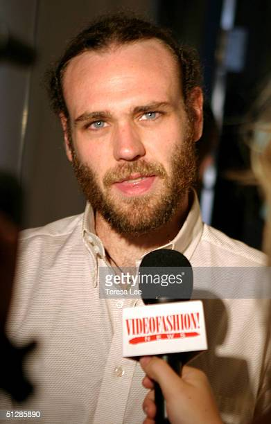 Fashion designer Frazer Harmon is interviewed backstage at the Harmon show during Olympus Fashion Week Spring 2005 at Niccolo September 10 2004 in...