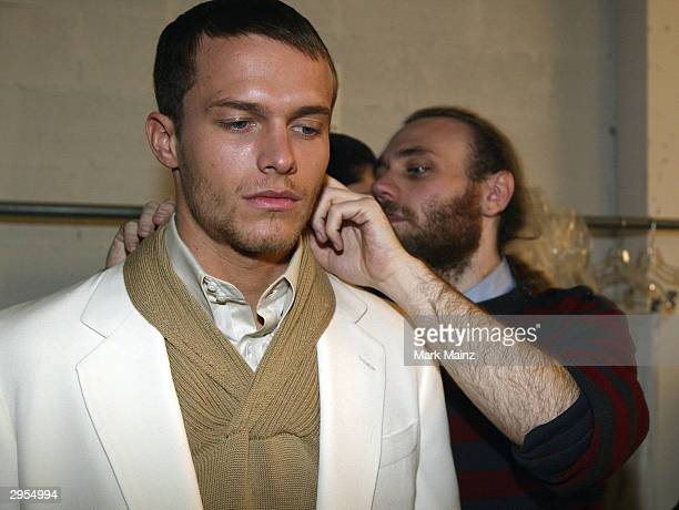 Fashion designer Frazer Harmon prepare for the runway backstage during the Harmon Fall 2004 fashion show at MAO/Atlas during the Olympus 2004 Fashion...