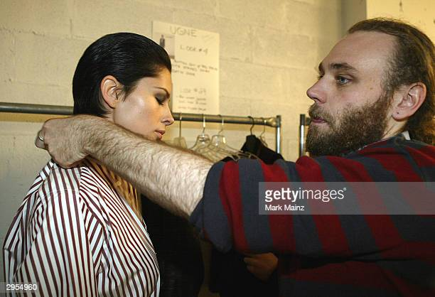 Fashion designer Frazer Harmon prepares for the runway backstage during the Harmon Fall 2004 fashion show at MAO/Atlas during the Olympus 2004...
