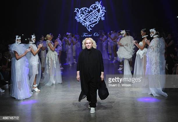 Fashion designer Furne One on the runway at the Amato show during Fashion Forward at Madinat Jumeirah on October 6 2014 in Dubai United Arab Emirates