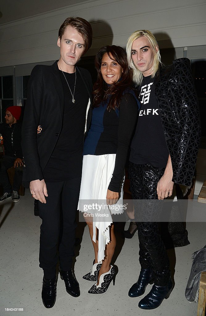 fashion designer Gareth Pugh, Laurie Lynn Stark and Carson McCall attends a dinner for Pugh hosted by Chrome Hearts at Malibu Farm on October 10, 2013 in Malibu, California.