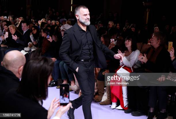 Fashion designer Georges Hobeika walks the runway after his Haute Couture Spring/Summer 2020 show as part of Paris Fashion Week on January 20 2020 in...