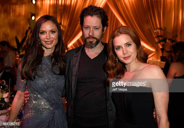 Fashion designer Georgina Chapman actor Darren Le Gallo and actress Amy Adams attend The Weinstein Company's Academy Awards Nominees Dinner in...