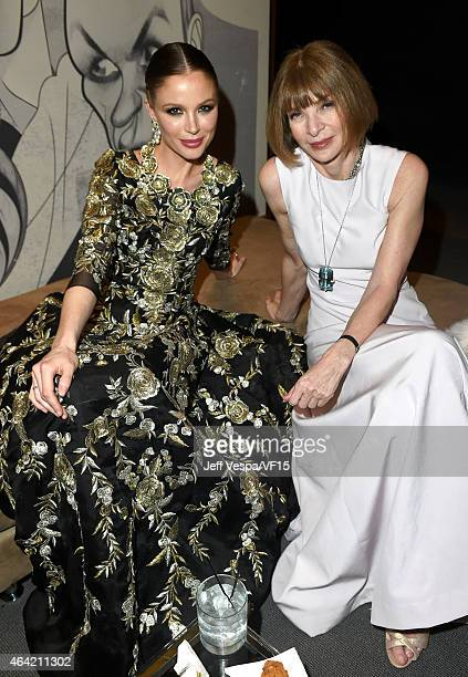 Fashion designer Georgina Chapman and Vogue magazine EditorinChief Anna Wintour attend the 2015 Vanity Fair Oscar Party hosted by Graydon Carter at...