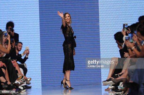 Fashion designer Georgina Chapman cofounder of Marchesa waves to the audience on the cat walk after her shows during the Arab Fashion Week in the...