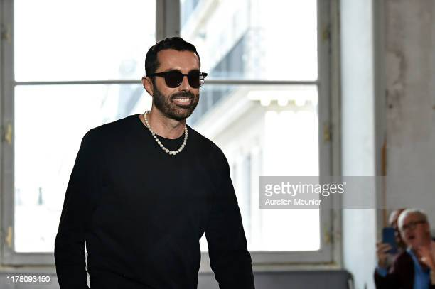 Fashion designer Giambattista Valli acknowledges the applause of the audience after his Womenswear Spring/Summer 2020 show as part of Paris Fashion...