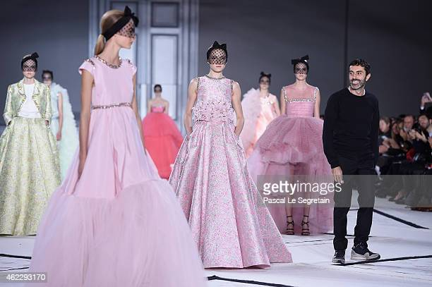 Fashion designer Giambattista Valli acknowledges the applause of the audience after the his show as part of Paris Fashion Week Haute Couture...
