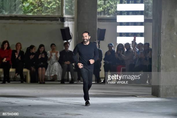 Fashion designer Giambattista Valli walks the runway during the Giambattista Valli Ready to Wear Spring/Summer 2018 fashion show as part of the Paris...