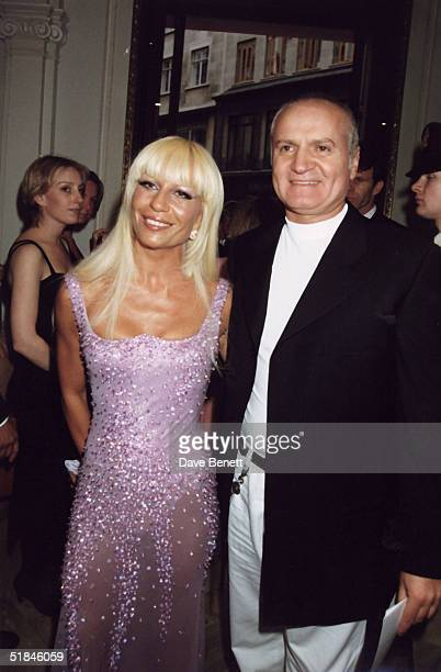 Fashion designer Gianni Versace and sister Donatella Versace attend an Elton John party on June 11 1995 in London England