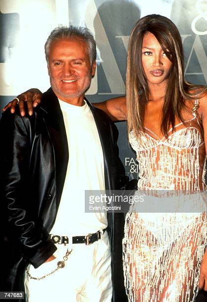 Fashion Designer Gianni Versace with model Naomi Campbell pose for photos at the VH-1 Fashion awards in New York City, December 3, 1995.