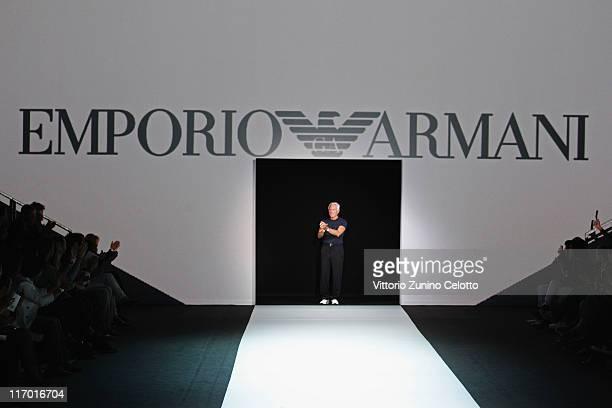 Fashion designer Giorgio Armani acknowledges the audience at the end of the Emporio Armani fashion show as part of Milan Fashion Week Menswear...
