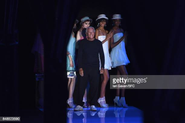 Fashion designer Giorgio Armani and models are seen on the runway during the finale of the Emporio Armani show at London Fashion Week September 2017...