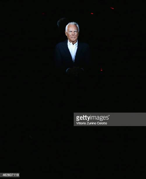 Fashion designer Giorgio Armani on the runway after his show as a part of Milan Fashion Week Menswear Autumn/Winter 2014 on January 14 2014 in Milan...