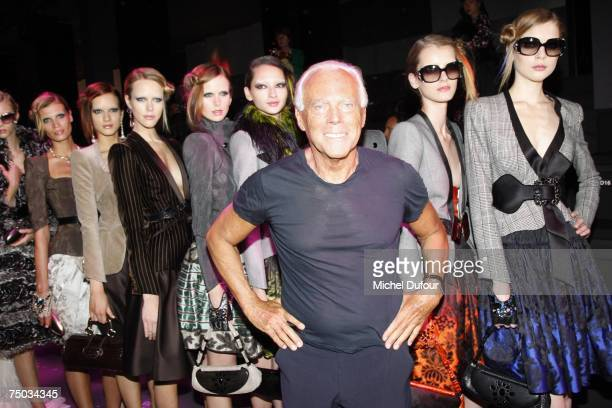 Fashion designer Giorgio Armani poses with his models at the Giorgio Armani Fashion show during Paris Fashion Week fall/winter 200708 at The Palais...