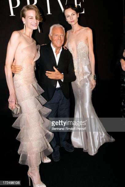 Fashion Designer Giorgio Armani stands between Models after the Giorgio Armani Prive show as part of Paris Fashion Week HauteCouture Fall/Winter...
