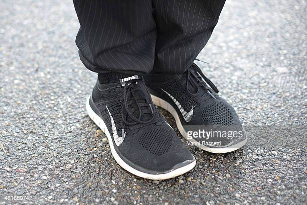 Fashion designer Giovanni Battista De Pol poses wearing Dead Meat pants and nike shoes on January 17 2015 in Milan Italy