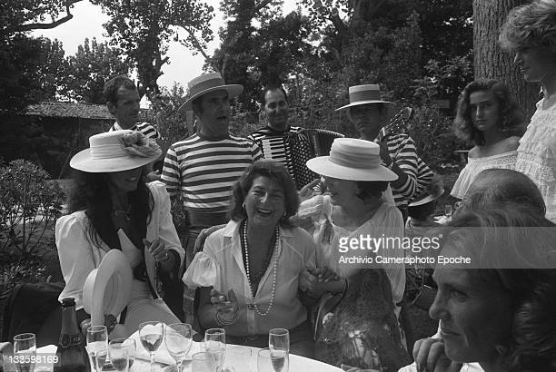 Fashion designer Giuliana Coen Di Camerino during an outdoor lunch in Venice for the 'Tribute to Ingrid' celebration Lido Venice 1983