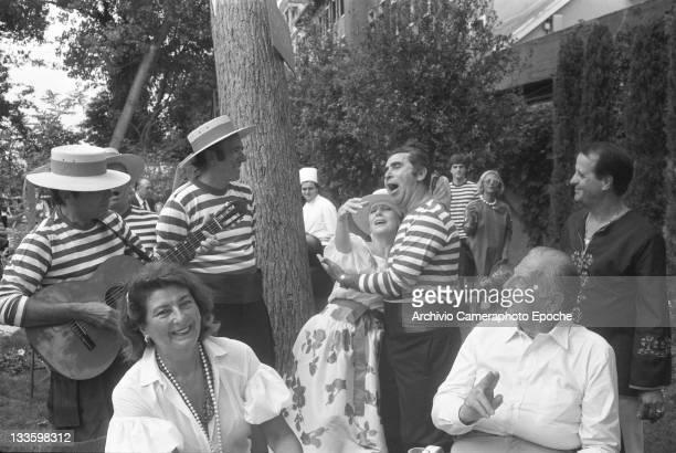 Fashion designer Giuliana Coen Di Camerino during an outdoor lunch in Venice for the 'Tribute to Ingrid' celebration Lido Venice 1983