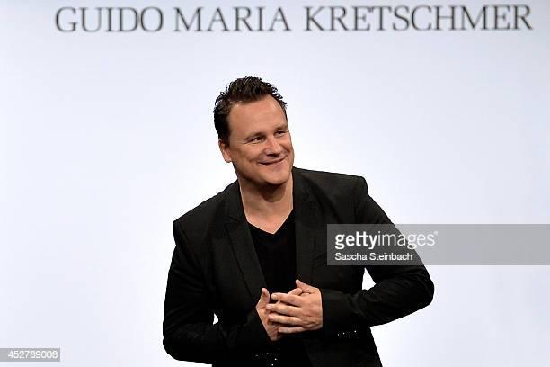 Fashion designer Guido Maria Kretschmer celebrates his show during Platform Fashion Dusseldorf on July 27 2014 in Duesseldorf Germany