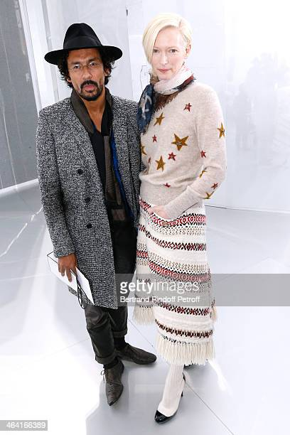 Fashion Designer Haider Ackermann and actress Tilda Swinton attend the Chanel show as part of Paris Fashion Week Haute Couture Spring/Summer 2014 on...