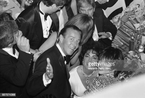 Fashion designer, Halston, actress Elizabeth Taylor and singer and actress Liza Minnelli smile at the opening night party for the Broadway revival of...