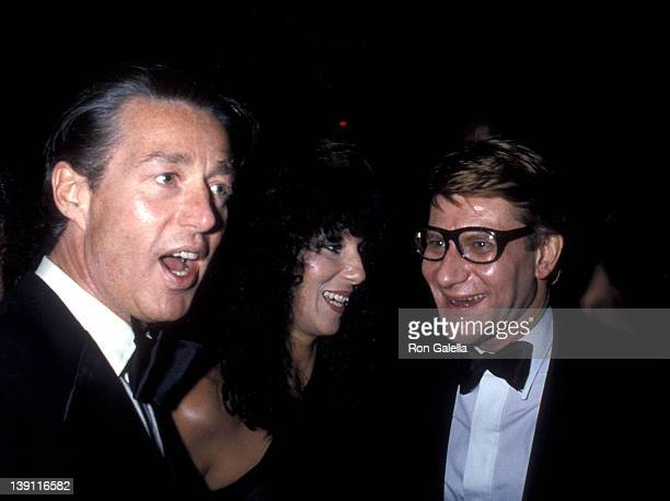 Fashion designer Halston singer Cher and fashion designer Yves Saint Laurent attend Yves Saint Laurent's 'Opium' Perfume Launch Party on September 20...