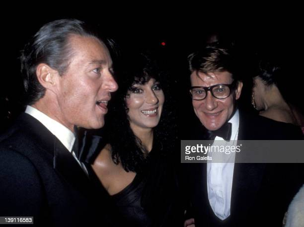 """Fashion designer Halston, singer Cher and fashion designer Yves Saint Laurent attend Yves Saint Laurent's """"Opium"""" Perfume Launch Party on September..."""