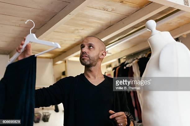 Fashion Designer hanging garment