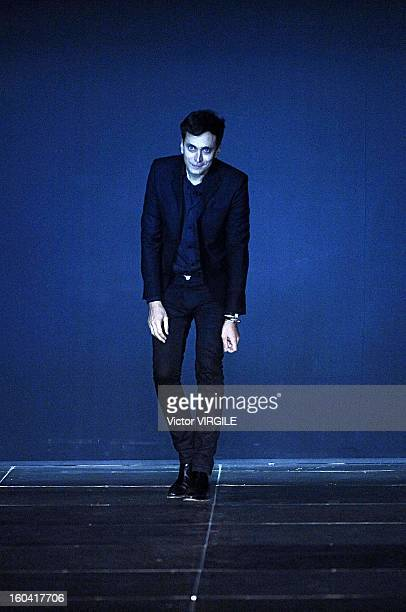 Fashion designer Hedi Slimane walks the runway at the Saint Laurent Spring Summer 2013 fashion show during Paris Fashion Week on October 1 2012 in...