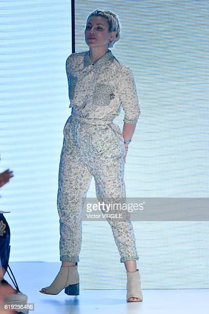 Fashion designer Helo Rocha walks the runway during the Helo Rocha show at Sao Paulo Fashion Week Fall/Winter 2017 on October 27 2016 in Sao Paulo...