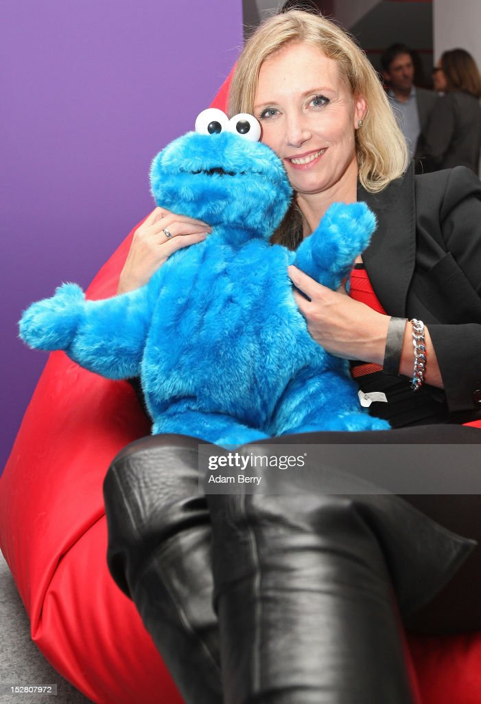 Fashion designer Henriette Elisabeth Joop, known as Jette Joop, poses with a Cookie Monster doll while sitting on a bean bag on September 26, 2012 at the official opening party of the Google offices in Berlin, Germany. Although the American company holds 95% of the German search engine market share and already has offices in Hamburg and Munich, its new offices on the prestigious Unter den Linden avenue are its first in the German capital. The Internet giant has been met with opposition in the country recently by the former president's wife, who has sued it based on search results for her name that she considers derogative. The European Commission has planned new data privacy regulations in a country where many residents opted in to have their homes pixeled out when the company introduced its Street View technology.