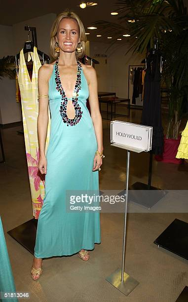 Fashion designer Holly Dunlap poses at the Hollywould Dress Collection launch party on December 1 2004 at Saks Fifth Avenue in Beverly Hills...