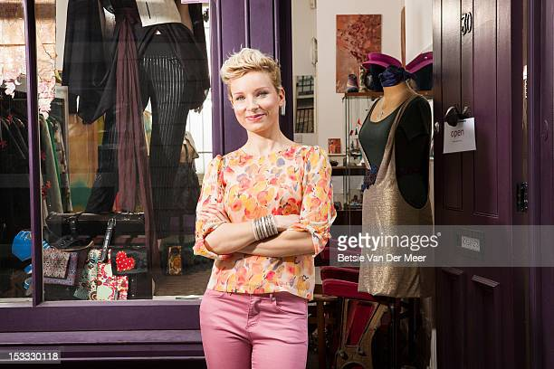 fashion designer in front of designer shop - design professional stock pictures, royalty-free photos & images