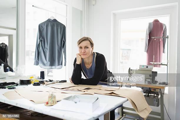 Fashion designer in her atelier at desktop