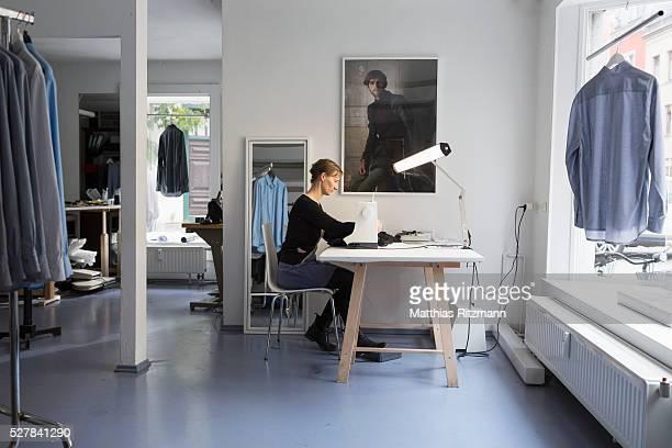 Fashion designer in her atelier at work