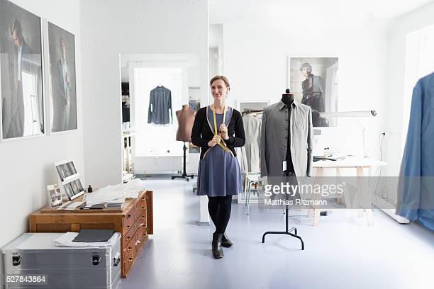 Fashion designer in her atelier