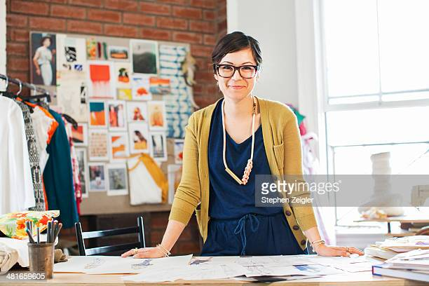 fashion designer in her studio - mid adult woman sweater stock pictures, royalty-free photos & images