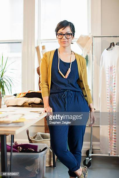 fashion designer in her studio - one mid adult woman only stock pictures, royalty-free photos & images