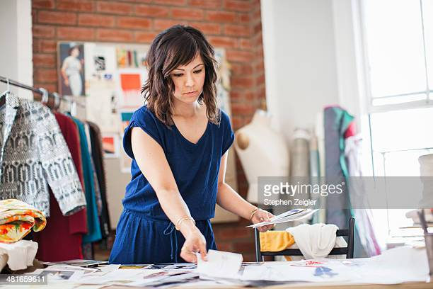 fashion designer in her studio - fashion collection stock pictures, royalty-free photos & images