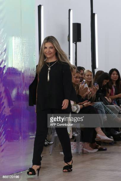 Fashion designer Ingie Chalhoub acknowledges the audience at the end of her women's 2018 Spring/Summer readytowear collection fashion show in Paris...