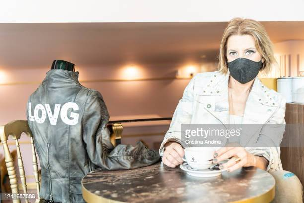 Fashion designer Inés Penelas poses next to a mannequin dressed in a jacket designed exclusively for the music group La oreja de Van Gogh in the...