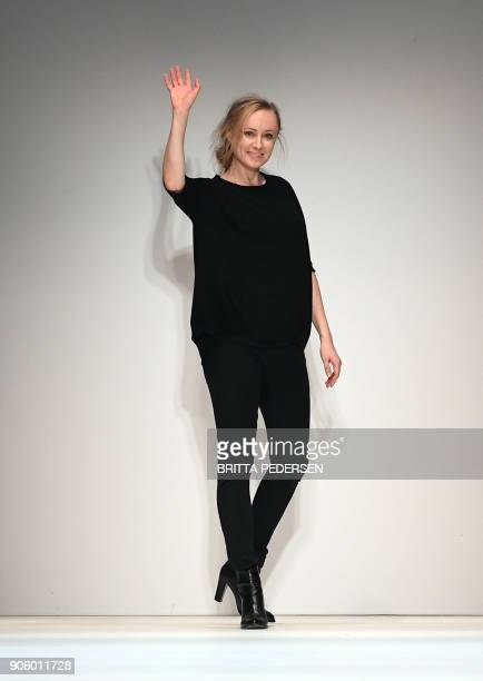 Fashion designer Irene Luft waves after the show of her label 'Irene Luft' during the Fashion Week in Berlin on January 17 2018 / AFP PHOTO / dpa /...
