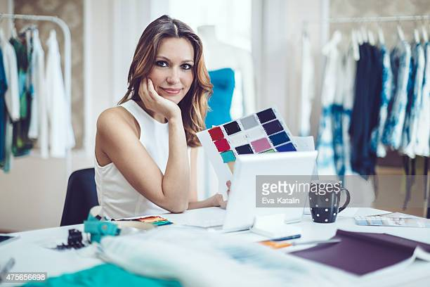 Fashion designer is in her office
