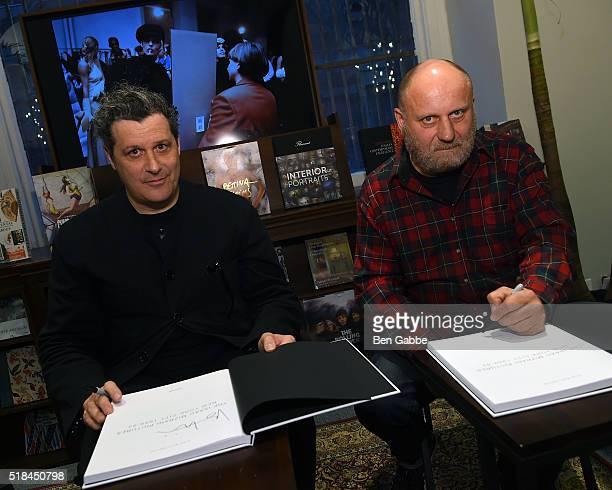 Fashion designer Isaac Mizrahi and artist/photographer Nick Waplington sign books during the Isaac Mizrahi Pictures New York City 19892003 Book...