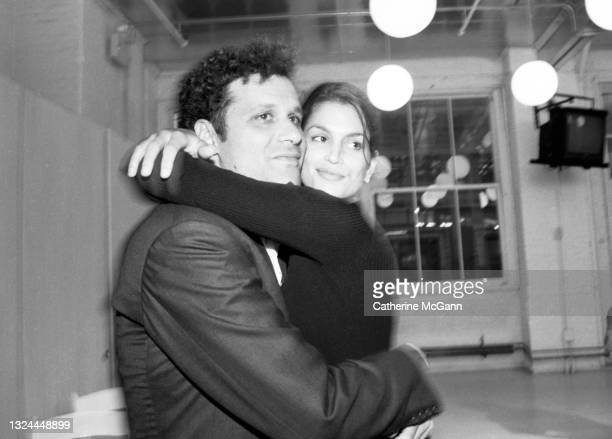 """Fashion designer Isaac Mizrahi and supermodel Cindy Crawford pose for a photo at Mizrahi""""u2019s Soho showroom in July 1996 in New York City, New York."""