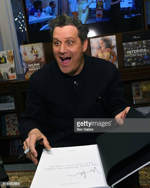 Fashion designer Isaac Mizrahi signs a book during the Isaac Mizrahi Pictures New York City 19892003 Book Celebration at Rizzoli Bookstore on March...