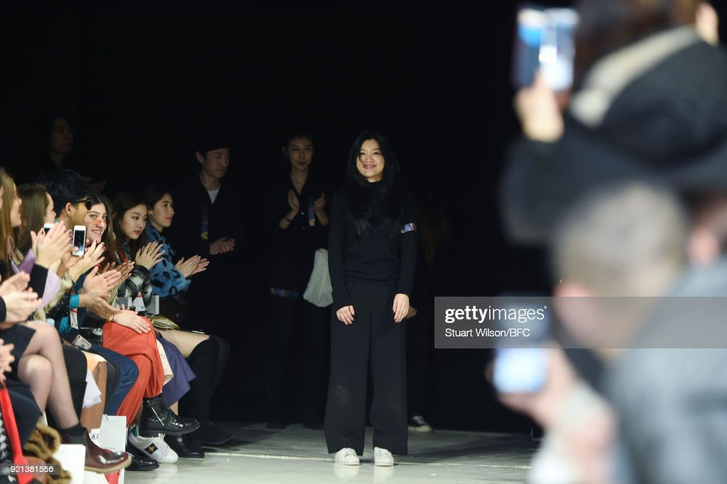 Fashion designer Jamie Wei Huang is seen on the runway at the Jamie Wei Huang presentation during London Fashion Week February 2018 on February 20, 2018 in London, England.