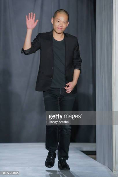 Fashion designer Jason Wu greets the audience at the end of his show during MercedesBenz Fashion Week Fall 2014 at 82 Mercer on February 7 2014 in...