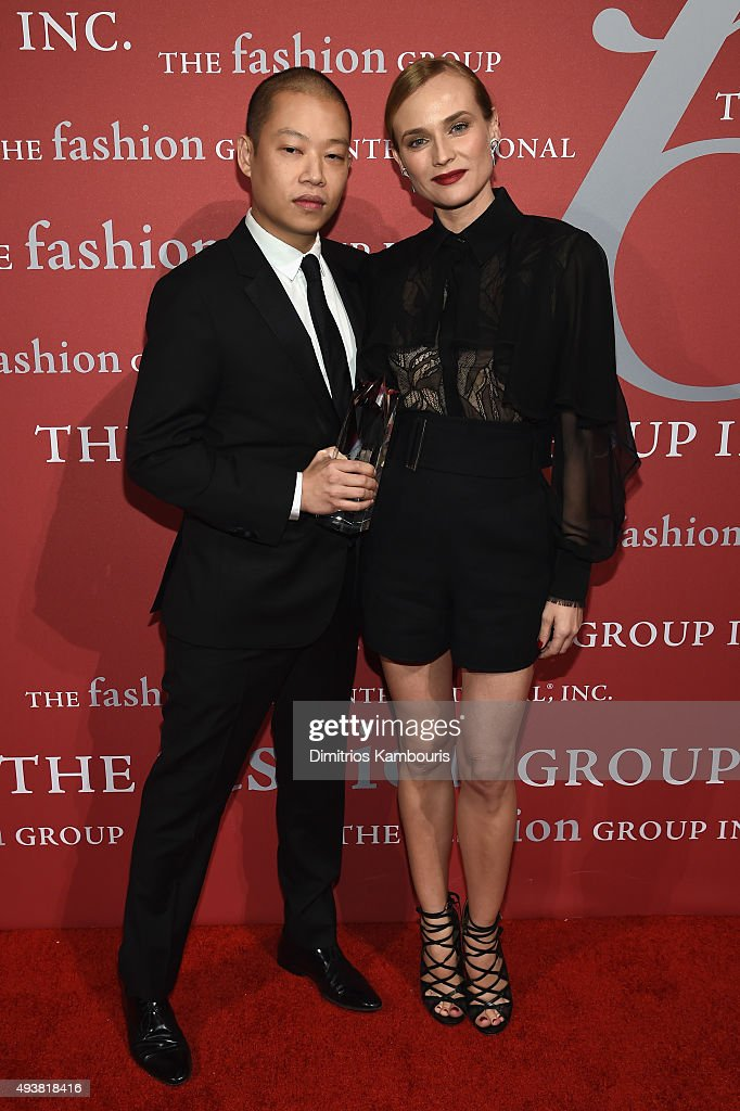Fashion Designer Jason Wu poses with his award and actress Diane Kruger at the 2015 Fashion Group International Night Of Stars Gala at Cipriani Wall Street on October 22, 2015 in New York City.